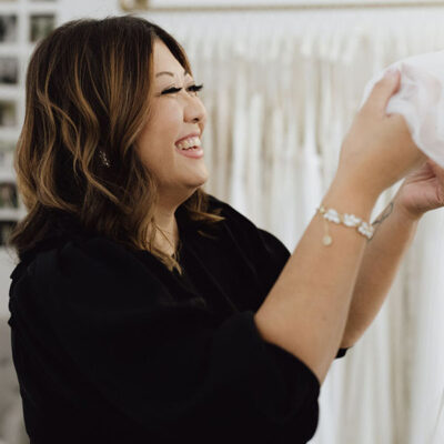 Earleen picking a dress for a bride - Revelle Bride